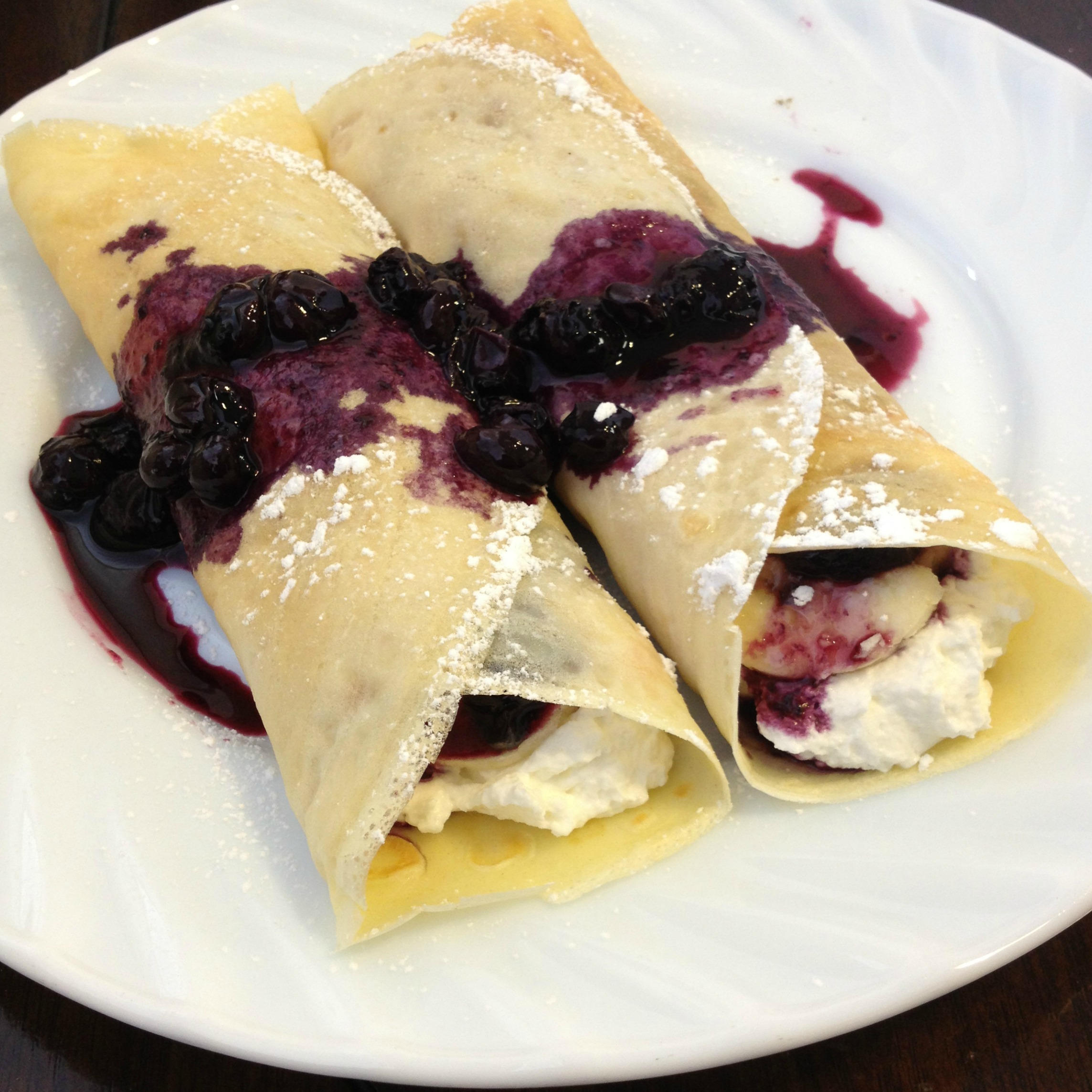 Crepes With Blueberry Sauce And Whipped Cream