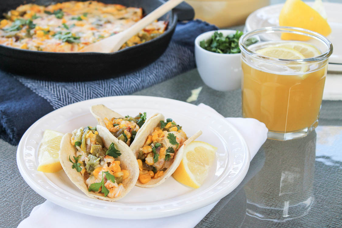 Grilled Anaheim chile and corn appetizer with melted queso enchillado